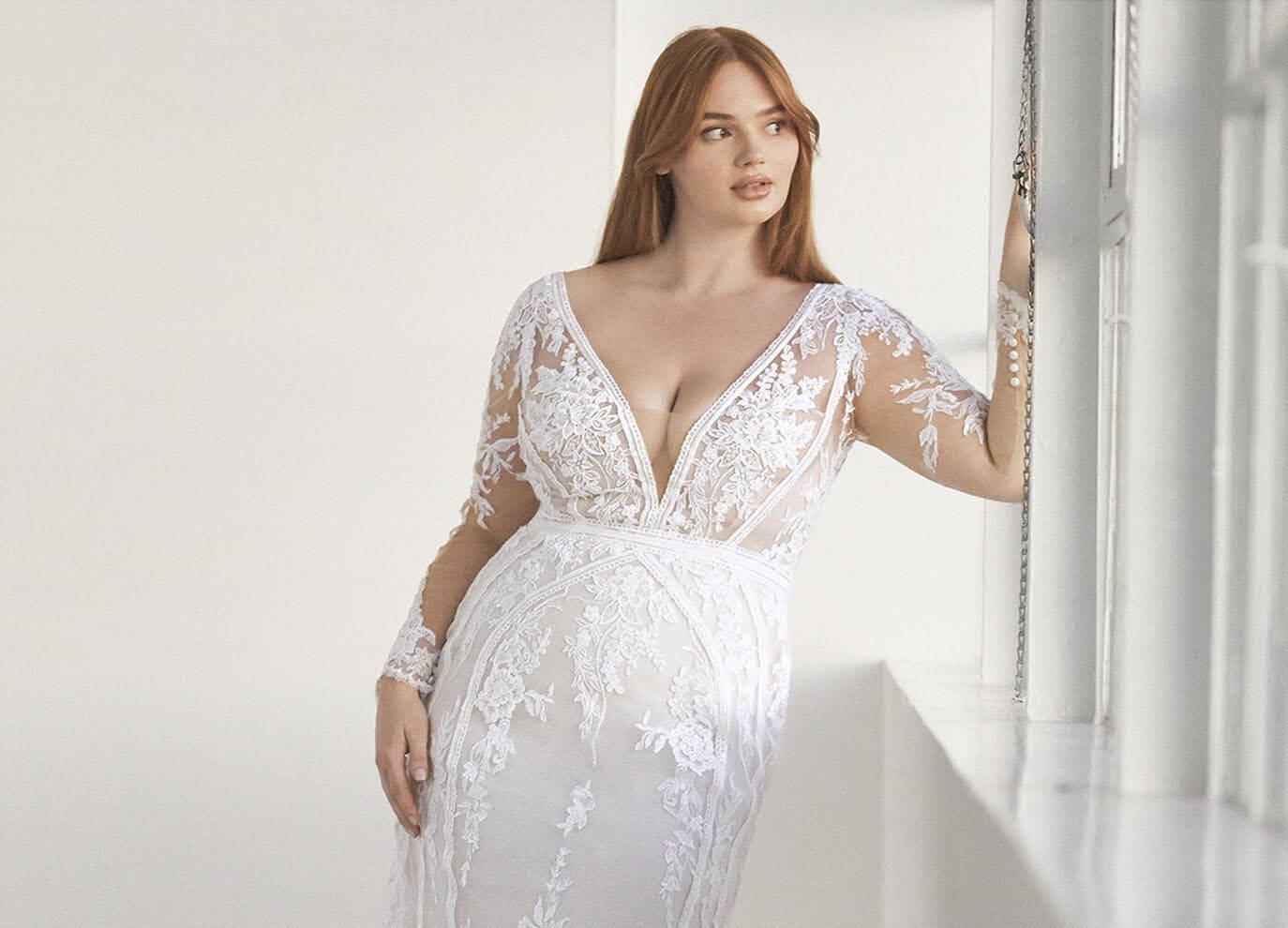 Plus size model wearing a Bridal Gown